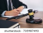 gavel on wooden table and... | Shutterstock . vector #735987493