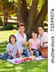 joyful family picnicking in the ... | Shutterstock . vector #73599076