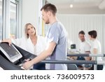 athlete on the treadmill he... | Shutterstock . vector #736009573