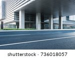 empty road with modern... | Shutterstock . vector #736018057