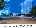 empty road with modern... | Shutterstock . vector #736018327