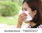 portrait of young woman blowing ... | Shutterstock . vector #736052317