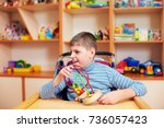 cheerful boy with disability at ... | Shutterstock . vector #736057423