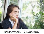unhappy housewife sitting near... | Shutterstock . vector #736068007