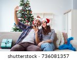 young pair taking selfies... | Shutterstock . vector #736081357