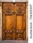 old ornate wooden door with...