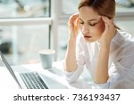 serious female person sitting... | Shutterstock . vector #736193437