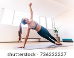 slim woman in side plank pose... | Shutterstock . vector #736232227