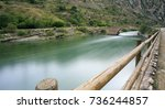 river crossing the mountains in ... | Shutterstock . vector #736244857