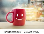 red mug of coffee with a happy... | Shutterstock . vector #736254937