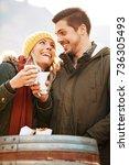young smiling couple enjoying... | Shutterstock . vector #736305493