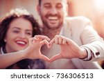close up of couple making heart ...   Shutterstock . vector #736306513