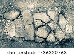 broken asphalt road with cracks | Shutterstock . vector #736320763