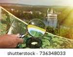 magnifying glass against map | Shutterstock . vector #736348033