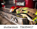 firefighter gear on truck bumper | Shutterstock . vector #736354417