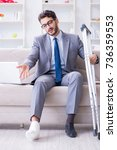 businessman with crutches and... | Shutterstock . vector #736359553