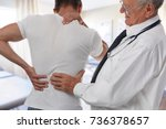 male doctor and patient... | Shutterstock . vector #736378657