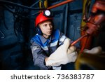 young coal miner is underground ... | Shutterstock . vector #736383787