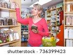 pretty woman customer looking... | Shutterstock . vector #736399423