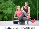 young woman exercising with... | Shutterstock . vector #736409563