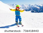 child skiing in the mountains.... | Shutterstock . vector #736418443