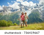 a happy couple is walking in... | Shutterstock . vector #736419667