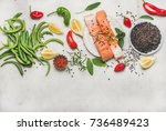 flat lay of raw salmon fish... | Shutterstock . vector #736489423