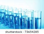 test tubes on blue background | Shutterstock . vector #73654285