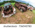 rusted old vehicles sit lined...   Shutterstock . vector #736543783