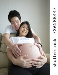 mom and dad hands on pregnant... | Shutterstock . vector #736588447
