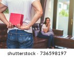 guy holding gift behind him for ... | Shutterstock . vector #736598197