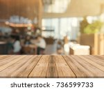 wooden board empty table top on ... | Shutterstock . vector #736599733