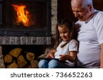 grandfather and granddaughter... | Shutterstock . vector #736652263