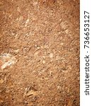 Small photo of Red laterite gravel for background