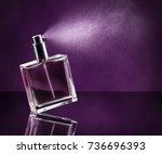 perfume bottle spraying on dark ... | Shutterstock . vector #736696393