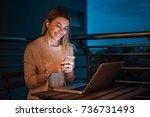 young beautiful woman using... | Shutterstock . vector #736731493