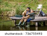 father and son fishing together ...   Shutterstock . vector #736755493