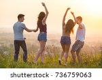 the four active people dancing... | Shutterstock . vector #736759063