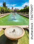 Small photo of Fountain in the famous gardens of Alcazar de los Reyes Cristianos in Cordoba in a beautiful summer day, Spain