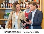 portrait of a man selling wine... | Shutterstock . vector #736793107