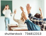 group of students raising hands ... | Shutterstock . vector #736812313