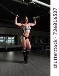muscular fitness woman doing... | Shutterstock . vector #736816537