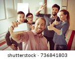 cheerful bearded man holding a... | Shutterstock . vector #736841803