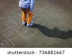 little boy playing hopscotch on ...   Shutterstock . vector #736881667