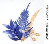 golden and blue gold leaf.... | Shutterstock . vector #736903513