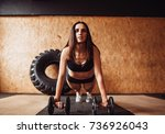 woman works out her shoulders... | Shutterstock . vector #736926043