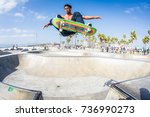 skateboarder catches air at...   Shutterstock . vector #736990273