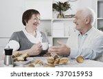 aged husband and wife enjoying