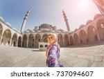 follow me. a muslim woman in a... | Shutterstock . vector #737094607