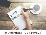 woman written 2018 resolutions... | Shutterstock . vector #737149627